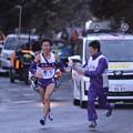 Photos: ここまで一位で快走の明大文元選手 給水ポイント・・20150102
